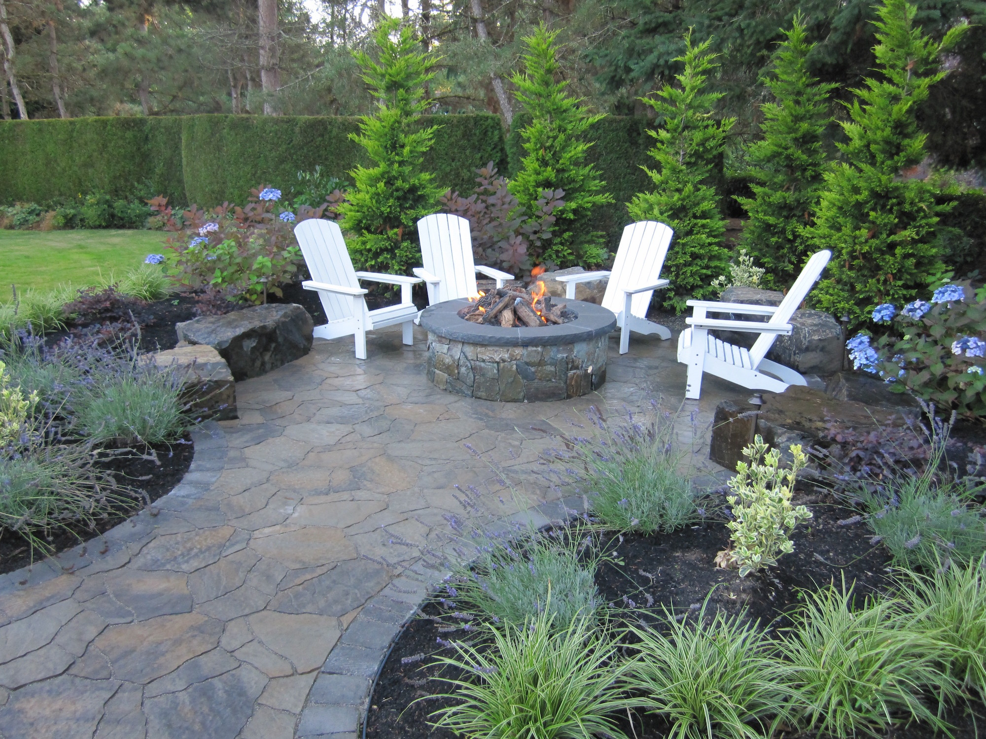 15 Fire Pit Ideas To Keep You Cozy Year Round on Garden Ideas With Fire Pit id=19801