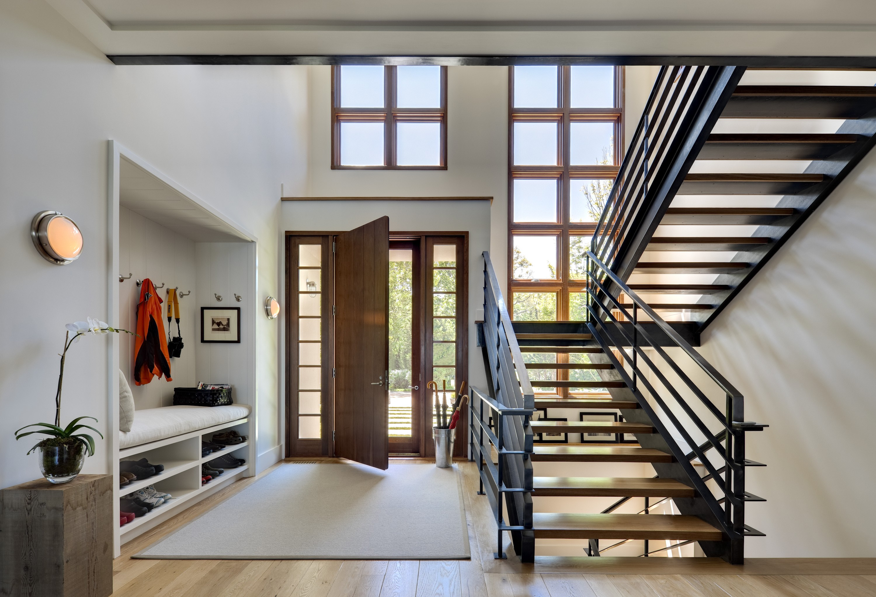 11 super organized entryways to clear the way for guests for House plans with foyer entrance