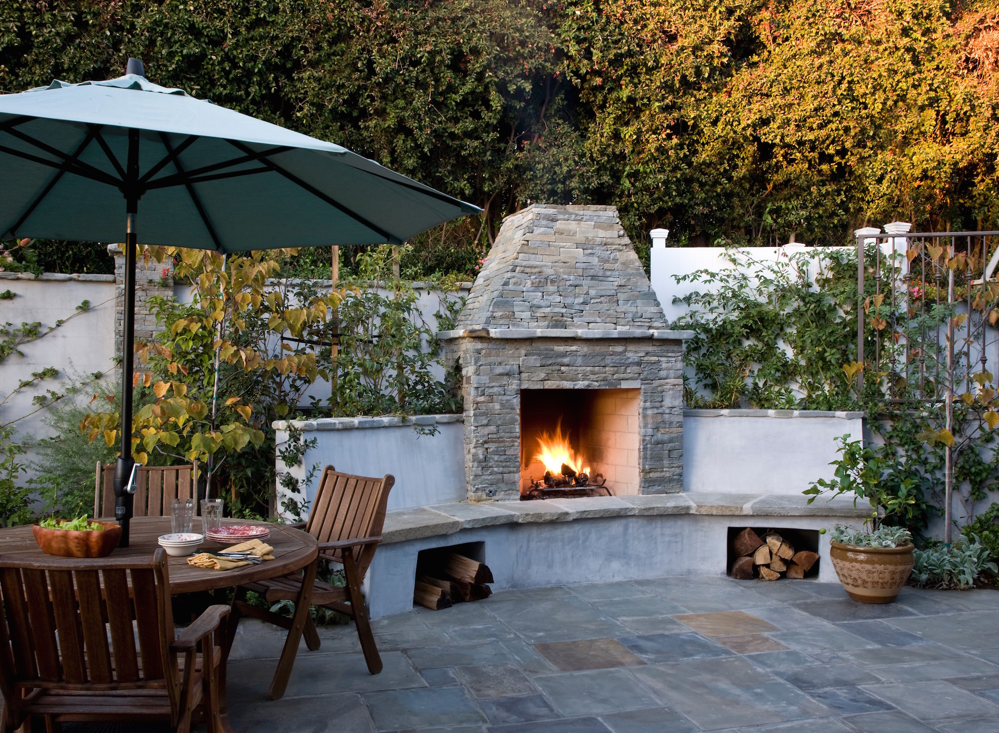 15 Fire Pit Ideas To Keep You Cozy Year Round