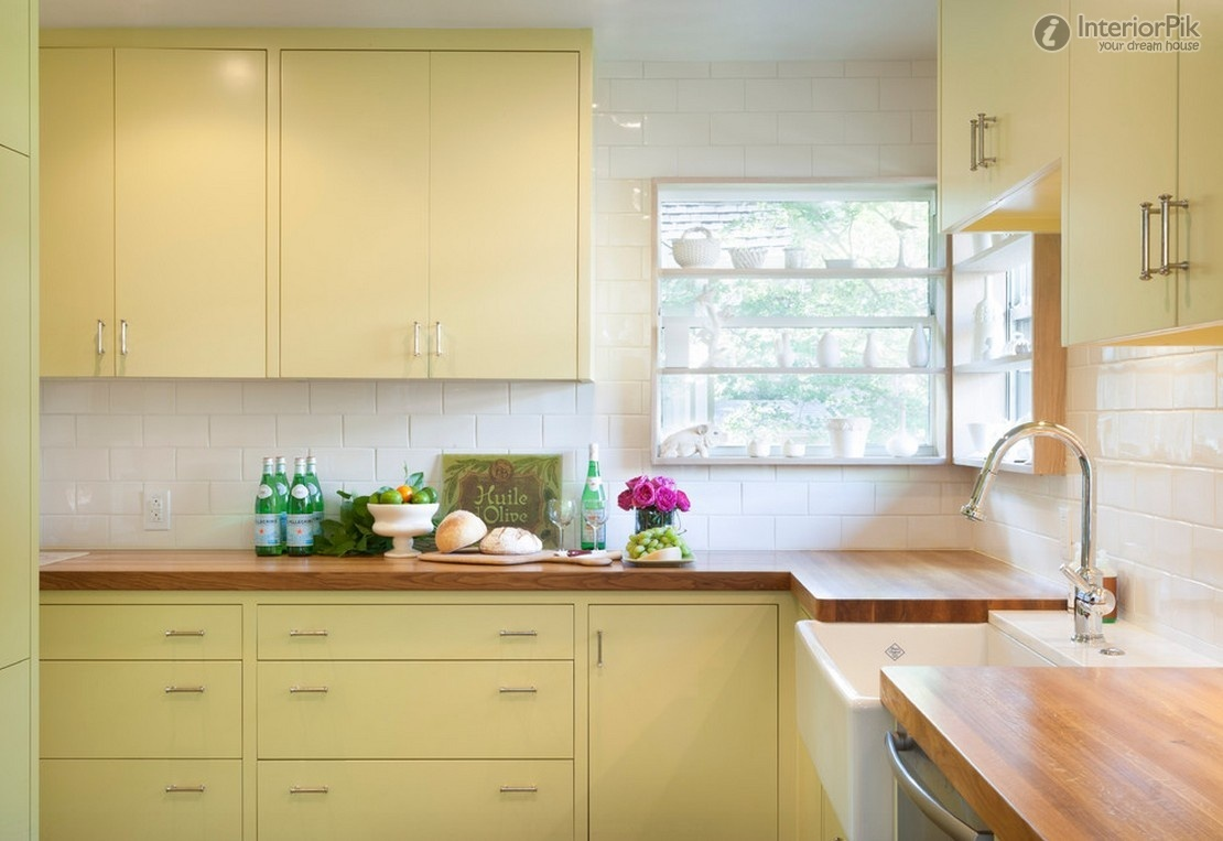 7 colorful kitchens that will make you want to paint your for Modern yellow kitchen cabinets