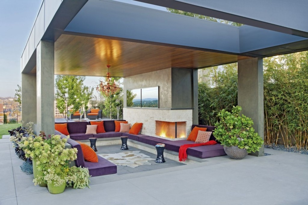 A colorful outdoor patio by Jeneration Interiors