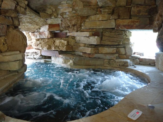 a grotto can be outfitted with an integrated spa or other features like a waterfall - Swimming Pools With Grottos