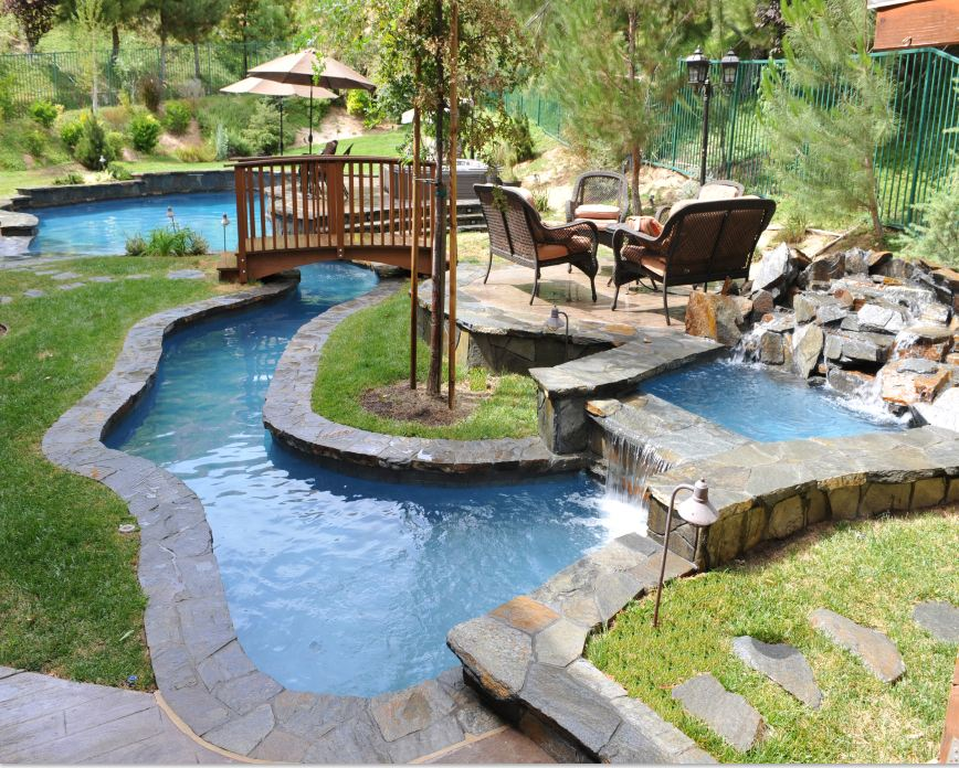 once reserved for hotels and resorts a lazy river is now part of residential pool. Interior Design Ideas. Home Design Ideas