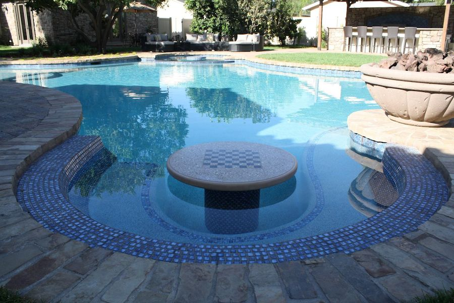 swimming pools with built in tables style