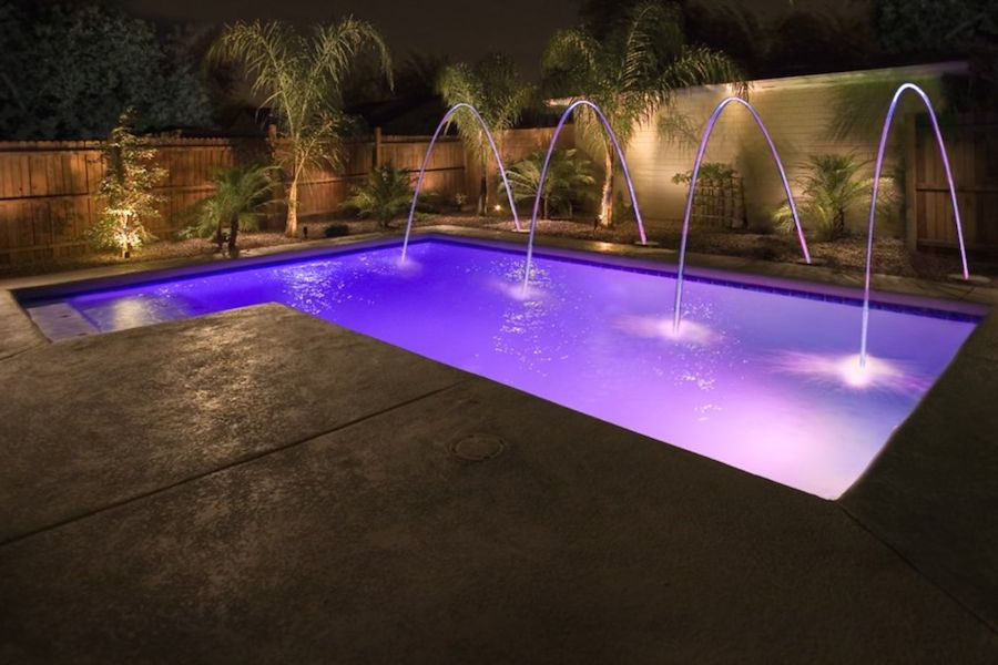 Colored Lights Can Add A Fun Design Element To Any Pool.