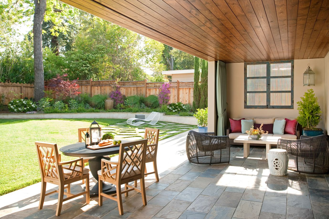 This Outdoor Space Feels Like A Living Room And Dining Room Thanks To  Carefully Chosen Furniture