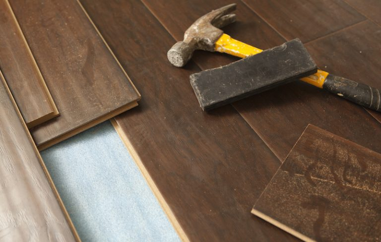 Luxury vinyl vs laminate flooring what s the difference for Laminate flooring contractors