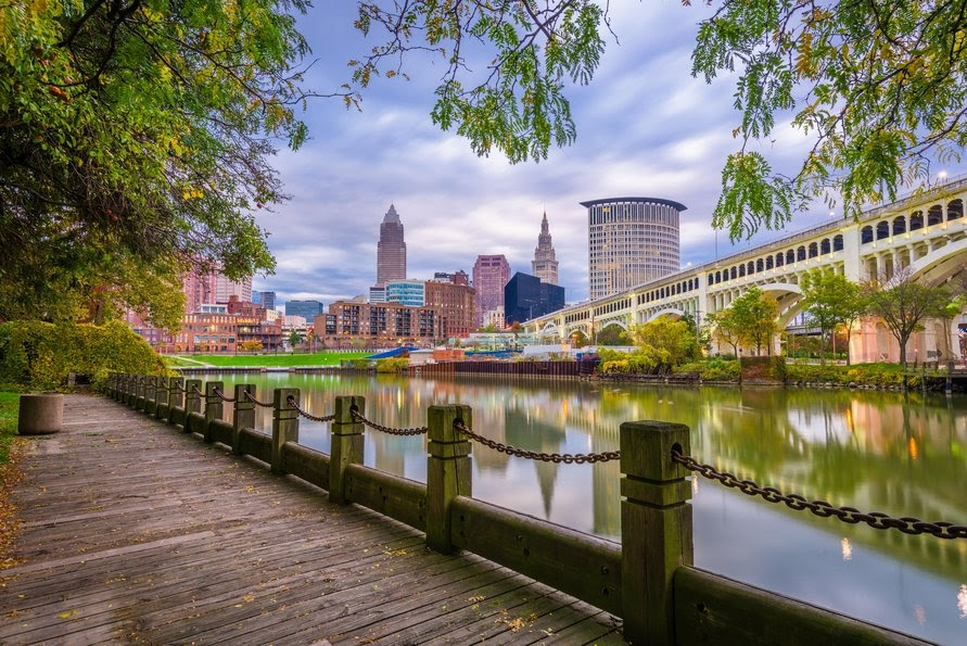 Downtown skyline on the Cuyahoga River at dusk. Cleveland, Ohio, USA