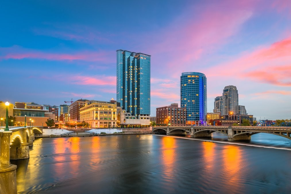 Downtown skyline on the Grand River at dusk. Grand Rapids, Michigan, USA